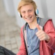 Teenage student thumb-up listen to music — Foto Stock