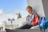 Student boy studying at university campus — Stock Photo