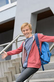 Student sliding down railing on stairway — Stock Photo