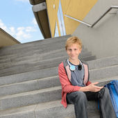Student with tablet sitting on steps — Stock Photo