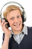 Teenage boy listening to music — Stock Photo