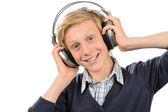 Happy boy listening to music — Zdjęcie stockowe