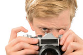 Boy photographing with retro camera — Stock Photo