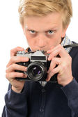 Boy photographing through retro camera — Stock Photo