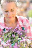Woman with purple flowers — Stock Photo