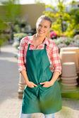 Garden worker posing in apron — Stock Photo