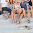 College students sitting on stairs — Stock Photo #48611189