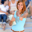Student girl giving thumb-up — Stock Photo #48611209