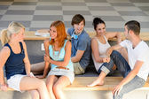 Students sitting on school bench — Stock Photo