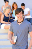 College student boy holding books — Stock Photo