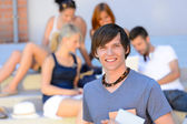 Smiling student boy with friends — Stock Photo