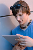 Student boy with tablet — Stock Photo