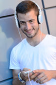 Student boy with headphones — Stockfoto