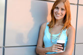 Student girl holding coffee cup — Stock Photo