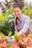 Garden center woman worker — Stock Photo