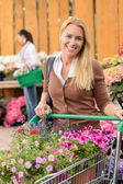 Woman buying flowers — Stock Photo