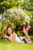 Girl lying in summer park — Stock Photo