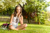 Girl sitting on grass — Stock Photo