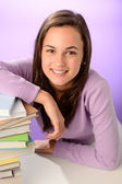 Student girl with pile of books — Stock Photo