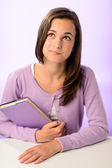 Student girl behind desk purple — Stock Photo