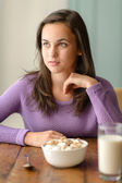 Woman with cereal breakfast table — Stock Photo