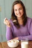 Girl enjoy healthy cereal breakfast — Stock Photo