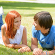 Couple lying on grass looking each other — Stock Photo #49565671