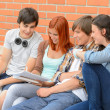 Group of students sitting bench outside college — Stock Photo #49566675