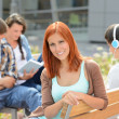 Student girl sitting outside campus with friends — Stock Photo #49566863