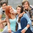 Cheerful friends hanging out by college campus — Stock Photo #49566865