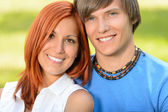 Teenage couple in love smiling sunny day — Stock Photo