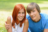 Teenage couple enjoy summer day smiling  — Stock Photo