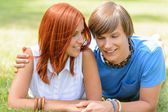 Teenage boyfriend and girlfriend lying on grass — Stok fotoğraf