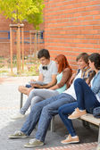 Group of students hanging out by college — Stock Photo