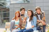Students friends sitting bench outside campus — Foto Stock