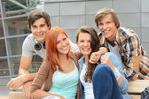 Cheerful student friends together outside campus — Stok fotoğraf