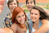 Group of student teenage friends taking selfie — Stock Photo