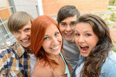 Cheerful student friends taking selfie — Stok fotoğraf