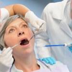 Dental check elderly woman patient dentist team — Stock Photo #49638037