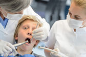Dentist assistant check teeth teenager boy patient — Stock Photo