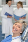 Senior woman patient at dentist surgery smiling — Stock Photo
