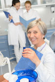 Elderly woman dentist team at dental surgery — Stock Photo