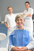 Senior woman patient with professional dentist team — Stock Photo