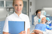 Dental assistant dentist checkup woman patient — Stock Photo