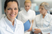 Professional dentist woman nurse with patient — Stock Photo