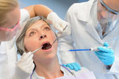 Dental check elderly woman patient dentist team — Stock Photo