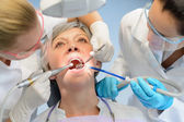 Senior woman patient dental check dentist team — Stock Photo