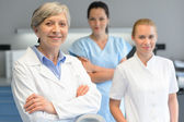 Medical professional team woman at dental surgery — Stock Photo