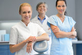 Three professional dentist woman at dental surgery — Stock Photo