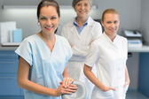 Three dentist woman team at dental surgery — Stock Photo